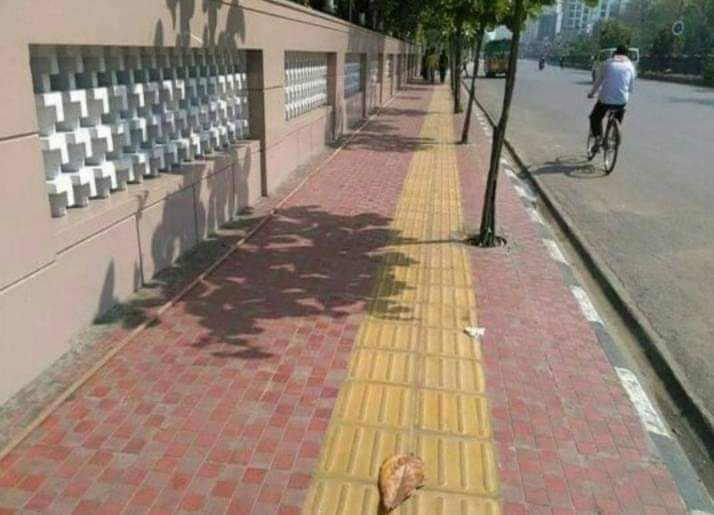 Yellow tiles on side walk bumps as tactile paving for visually impaired or blink people